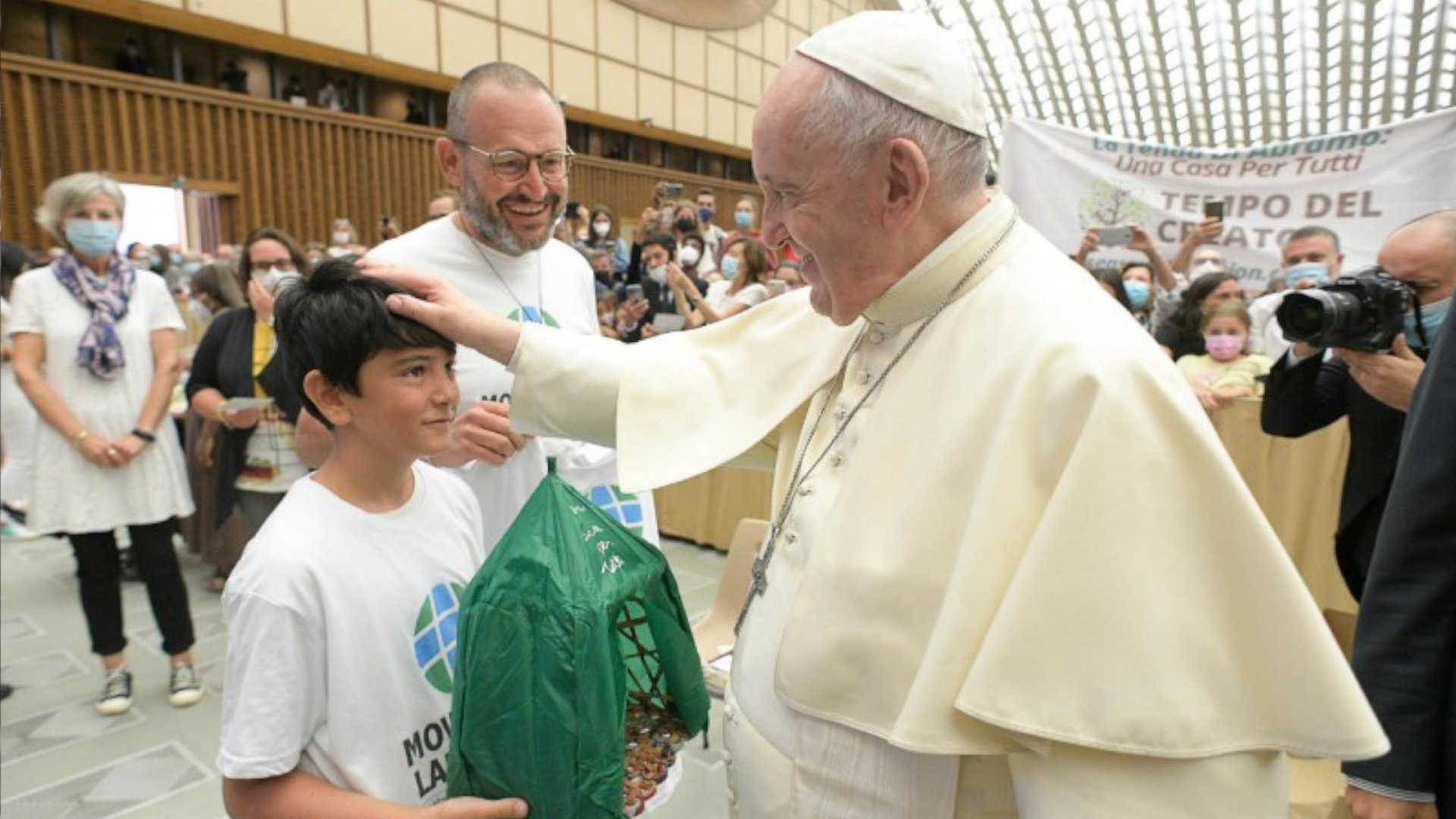 Pope Francis receives the gift of a tent to start the Season of Creation. Photo credit: Vatican News.